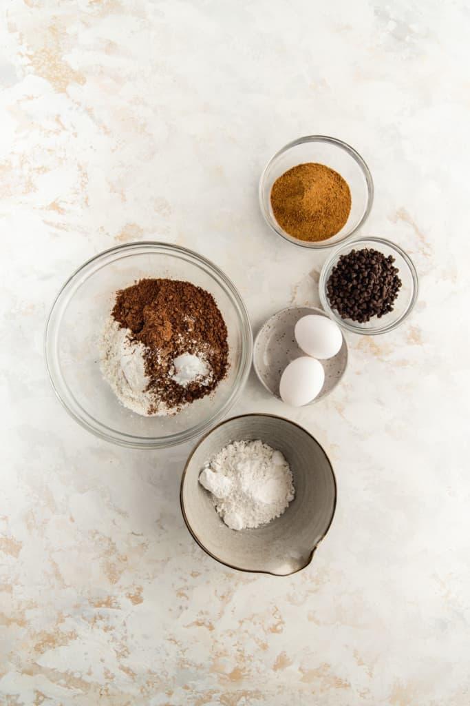 makings of chocolate crinkle cookies in bowls