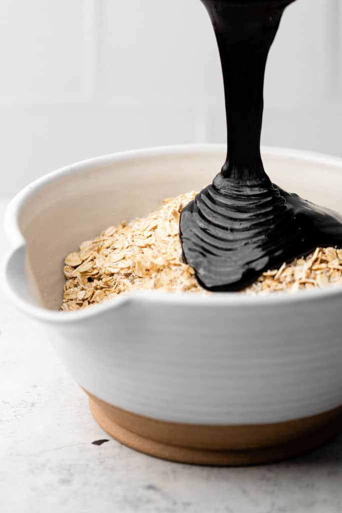 pouring chocolate onto oats