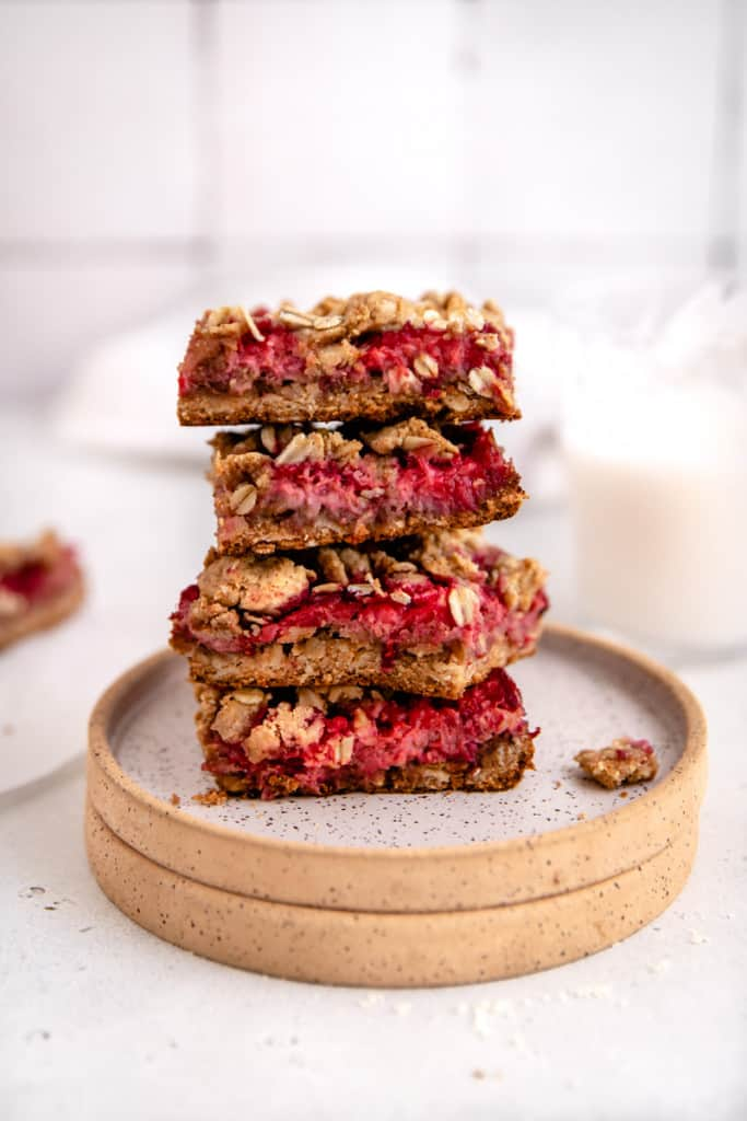 raspberry oat bars stacked up