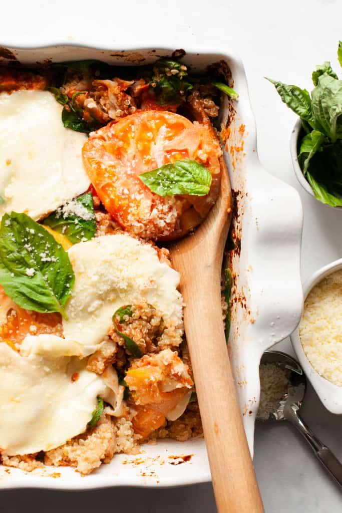 caprese chicken quinoa casserole with spoon