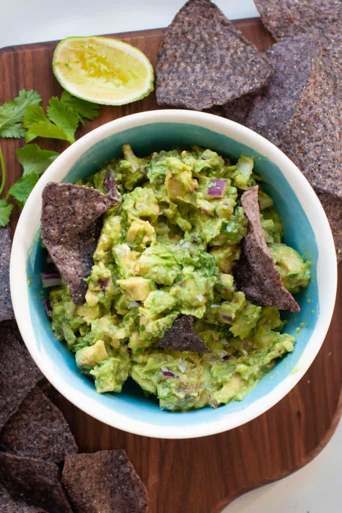 guacamole in a bowl with chips