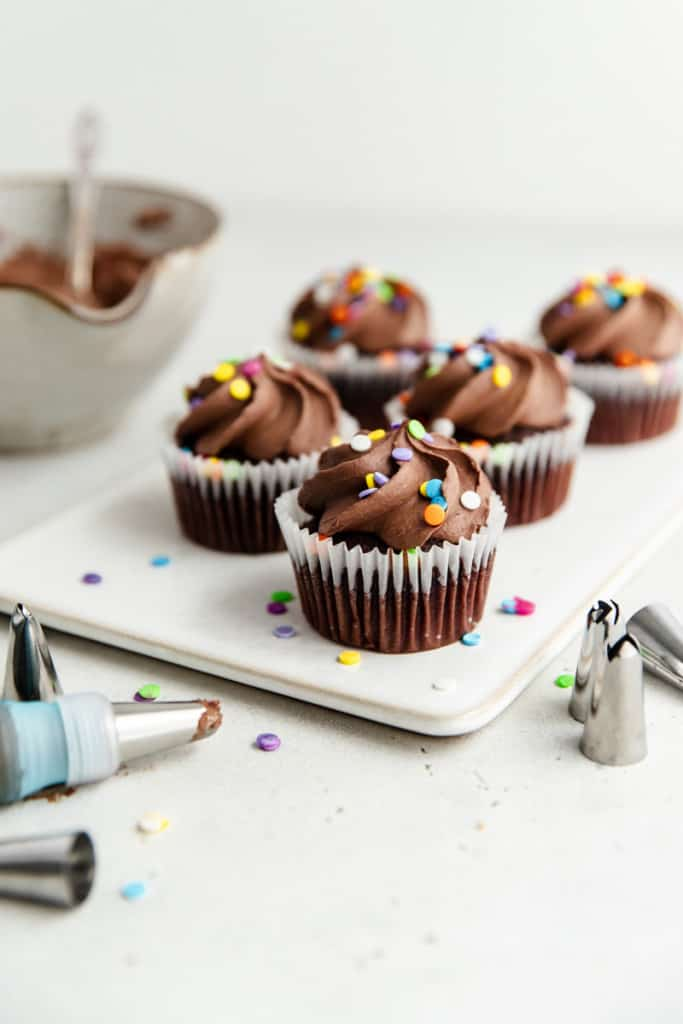 homemade chocolate frosting on cupcakes