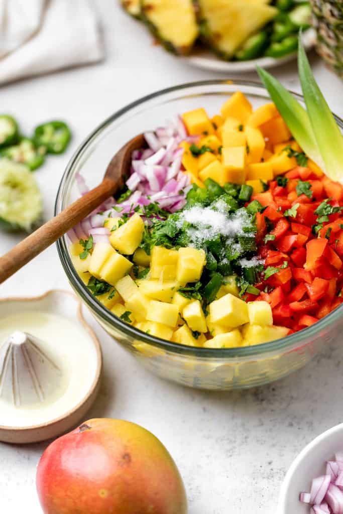 making pineapple mango salsa