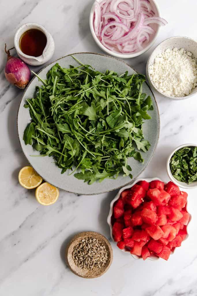 making watermelon feta salad