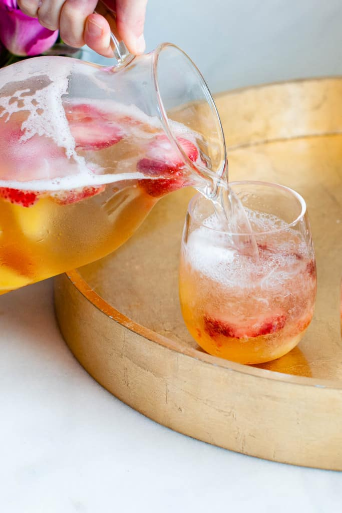 pouring easy white sangria in glasses