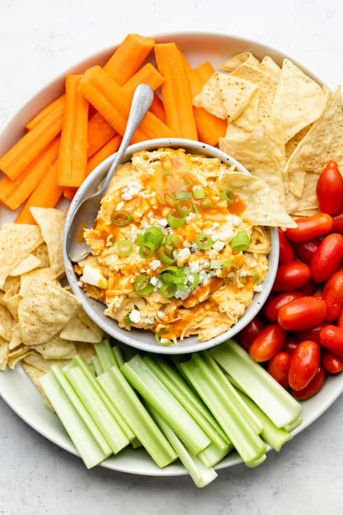 platter with healthy buffalo chicken dip and veggies