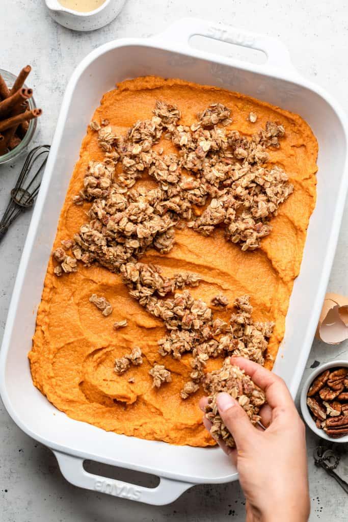 putting crumble on sweet potato casserole
